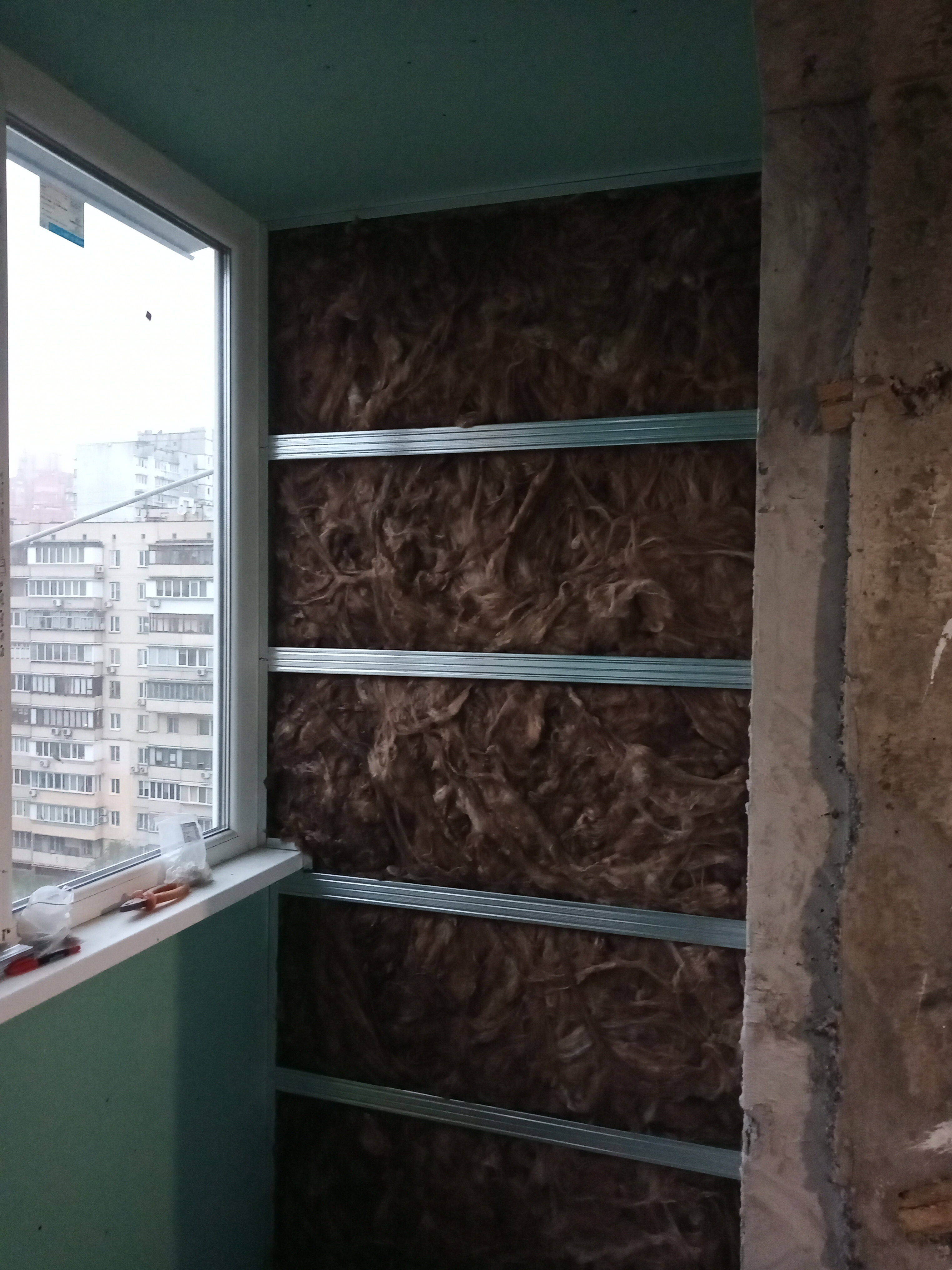 Фото Обшивка балкона гипсокартоном с утеплителем