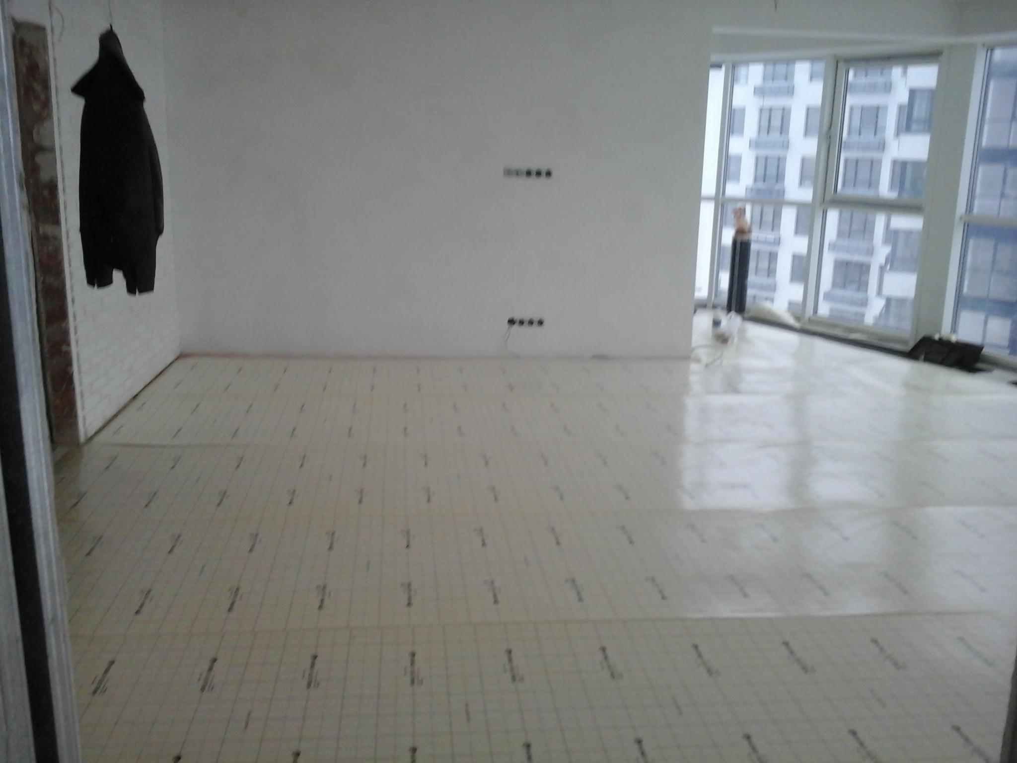 Фото Установка инфракрасного пленочного теплого пола под ламинат как отопление смарт квартиры. г. Киев ул. Заречная 2Г. монтаж проводился 8 часов.