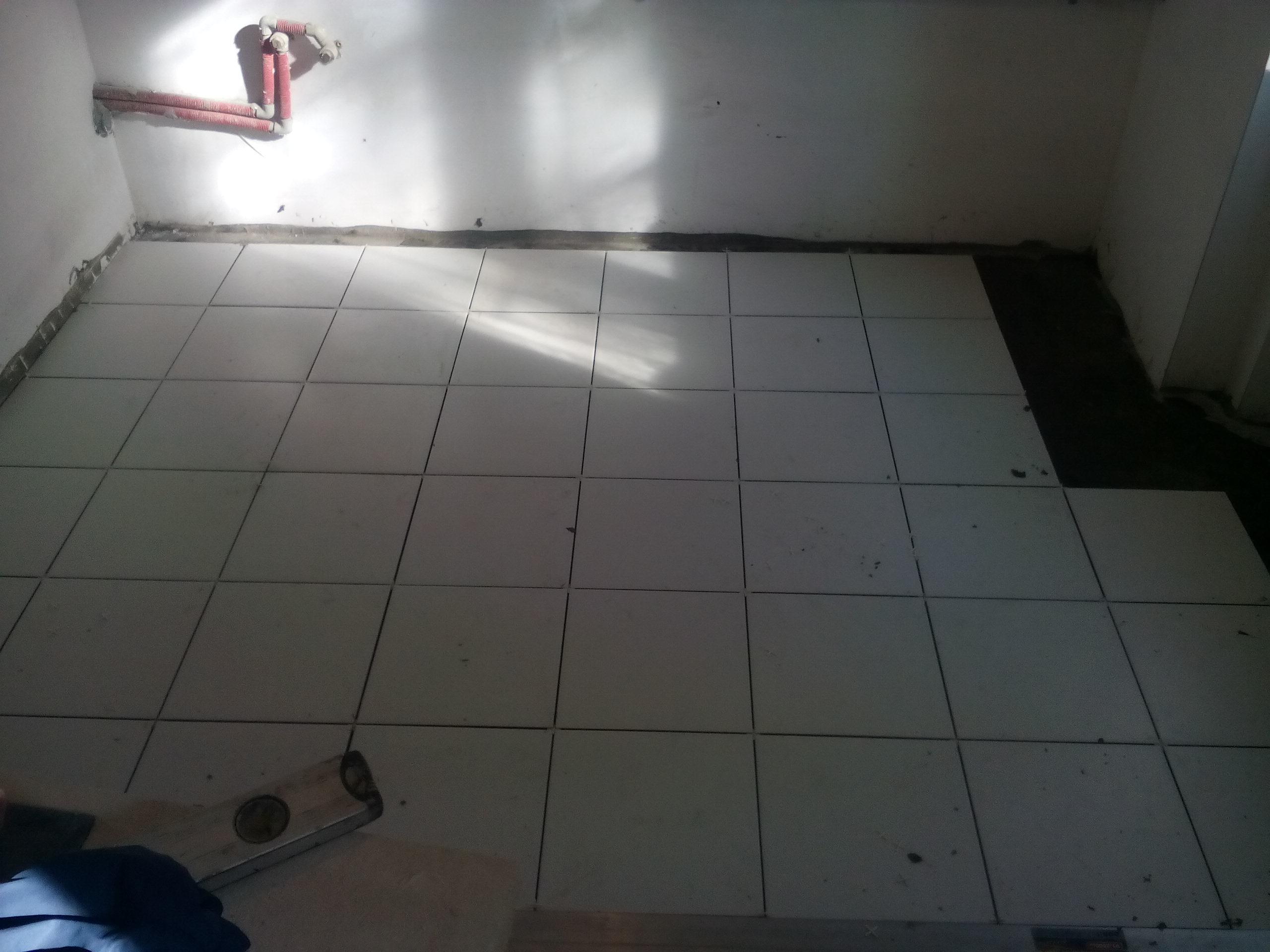 Фото Укладка плитки на пол