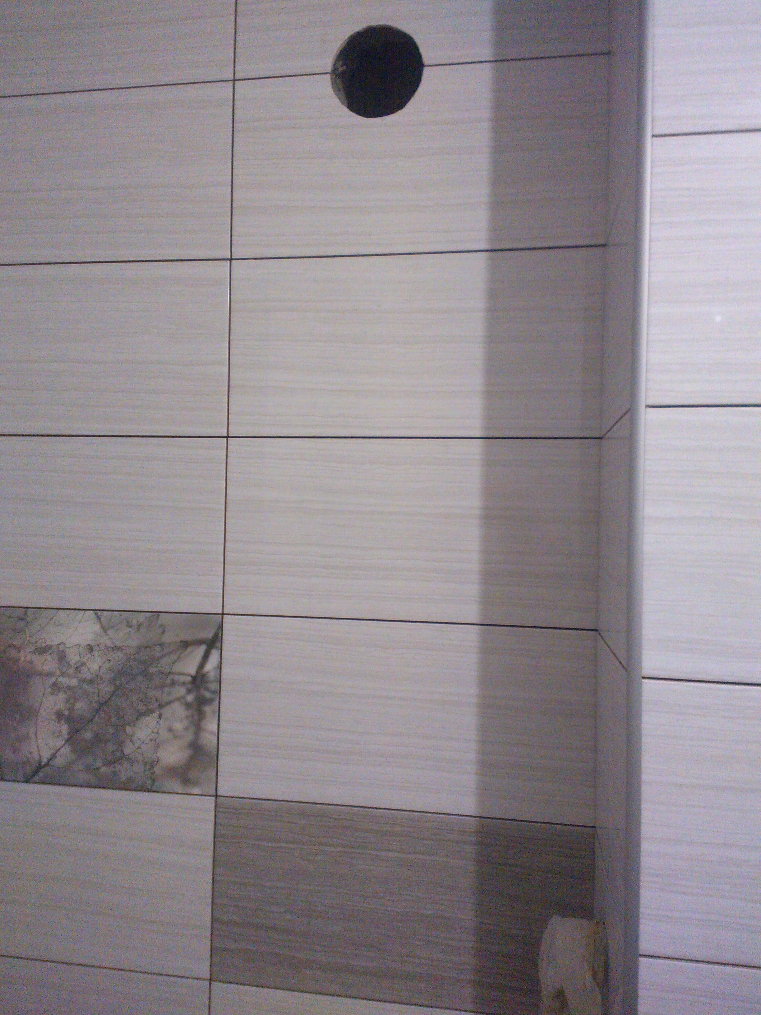 Фото Укладка плитки в ванной..