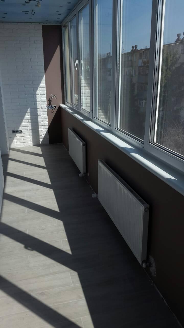 Фото Монтаж стальных панельных радиаторов.