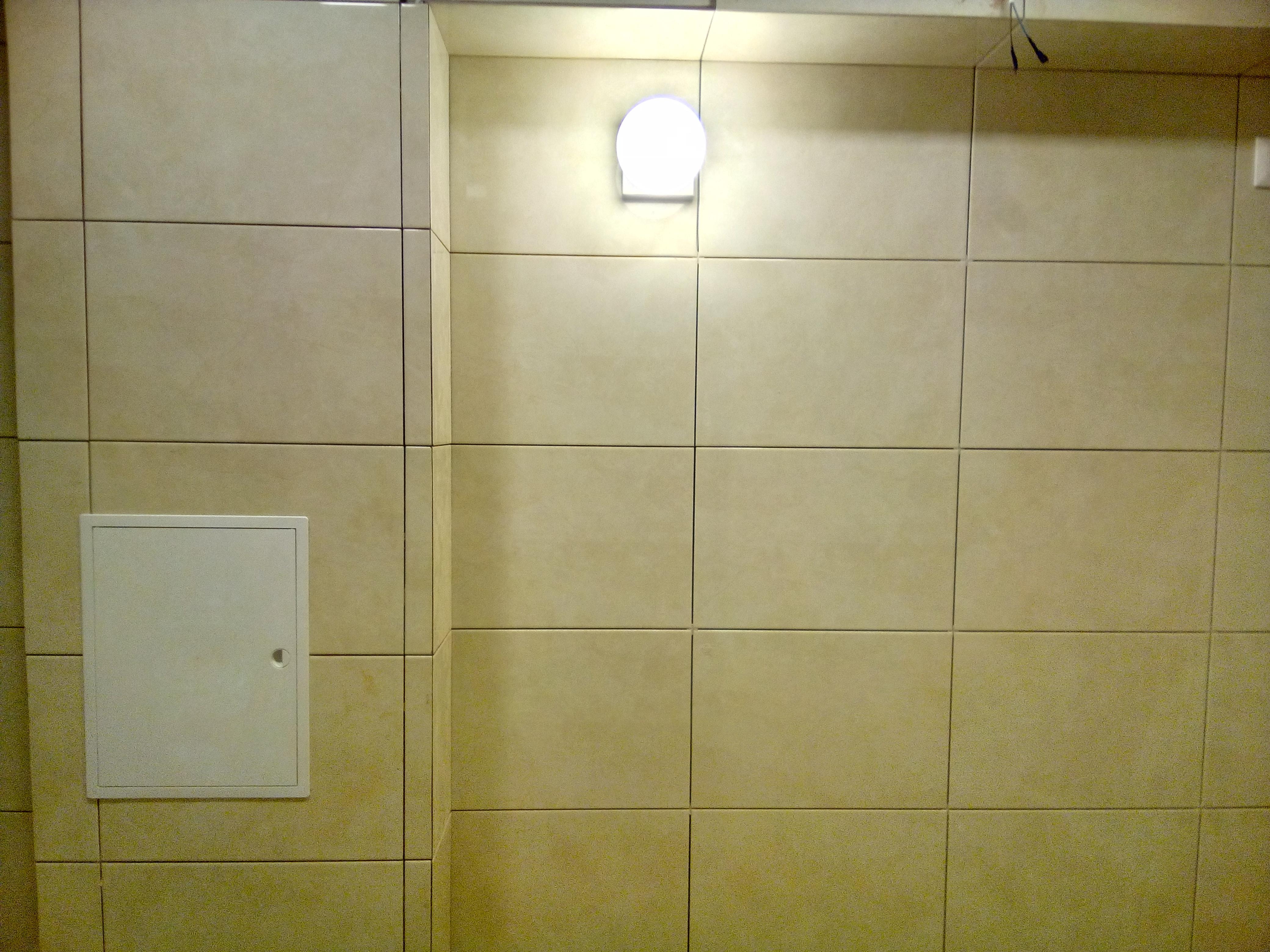 Фото Кладка плитки в ванной