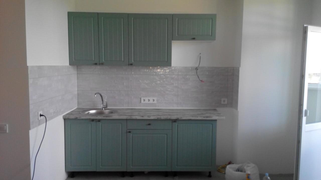 Фото Сборка и установка кухни с врезкой мойки