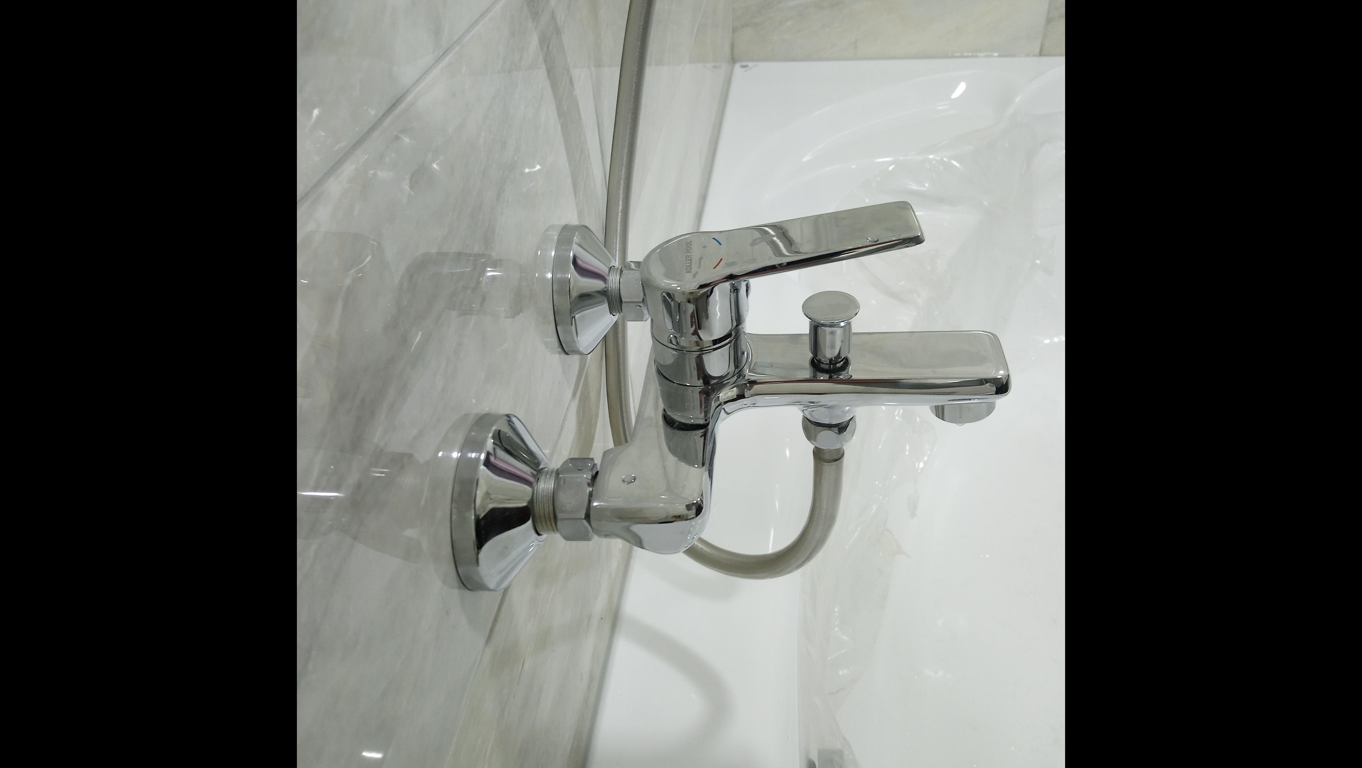 Фото Установка смесителя ванны