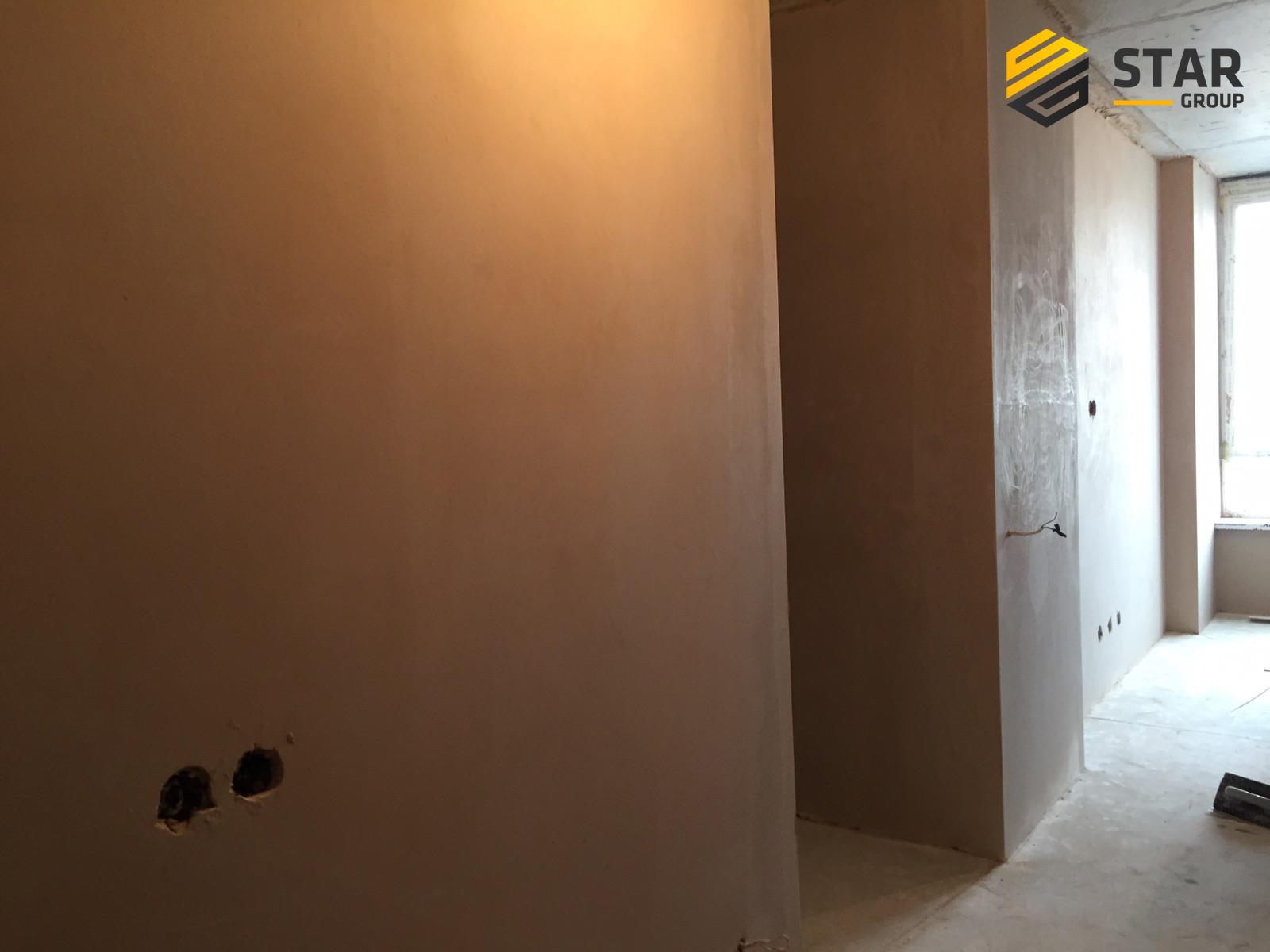 Фото Машинная штукатурка стен и откосов.