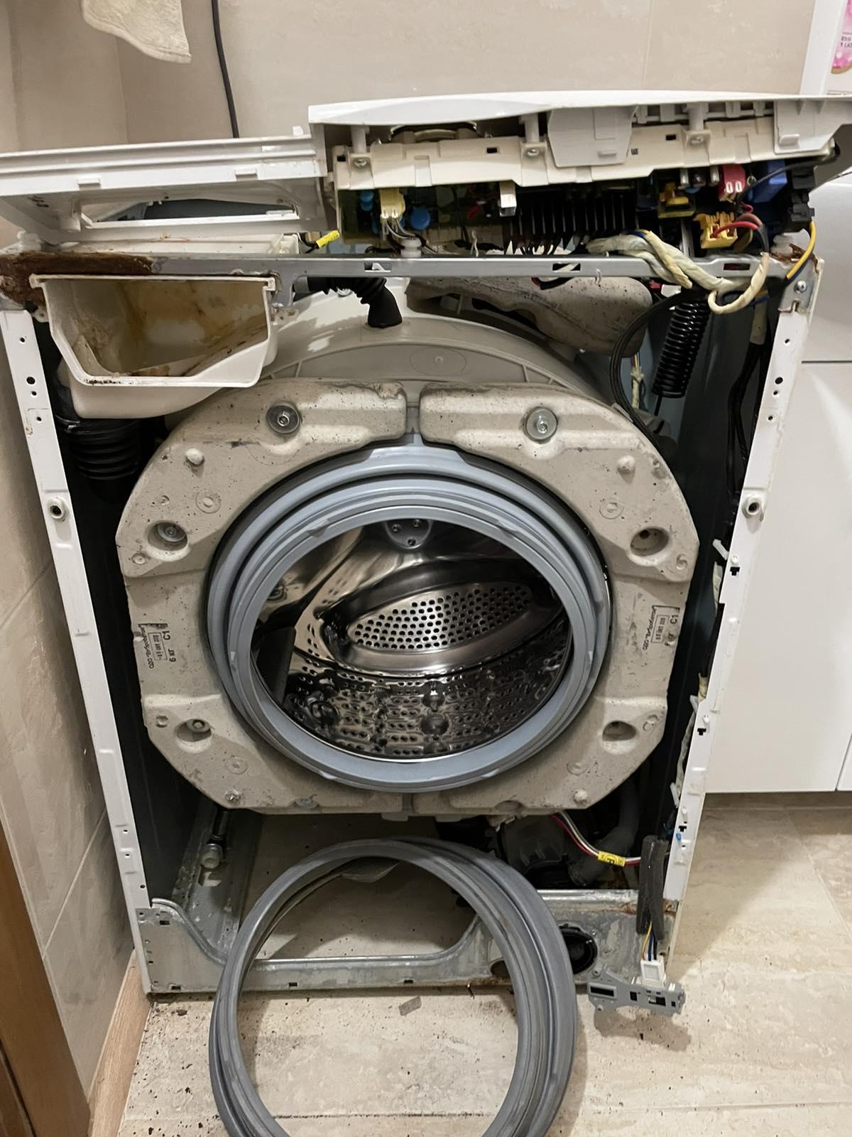 Фото Замена манжеты ( резины) на стиральной машинке LG