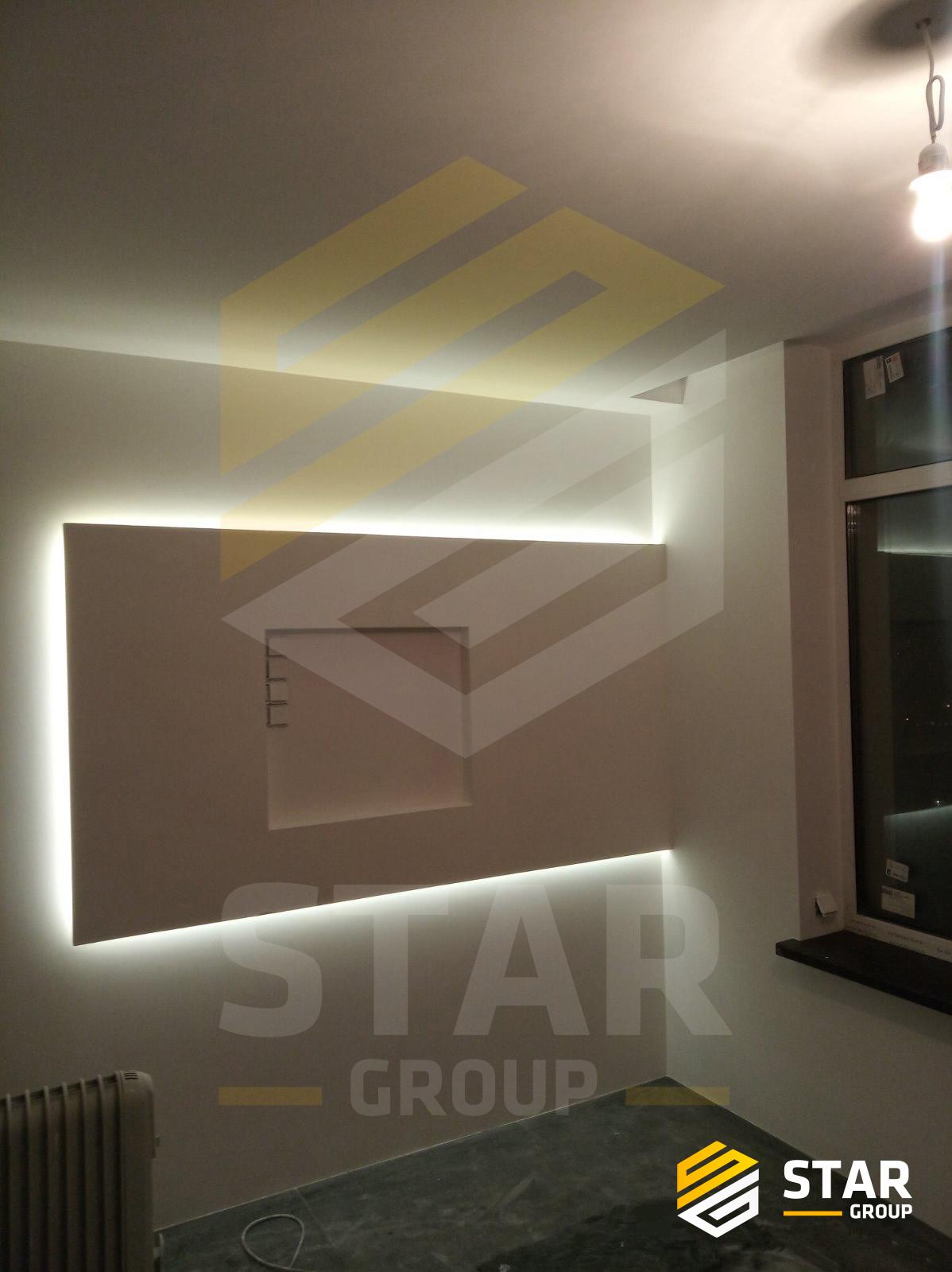 Фото Конструкция под ТВ из гипсокартона с спрятанной лэд подсветкой.